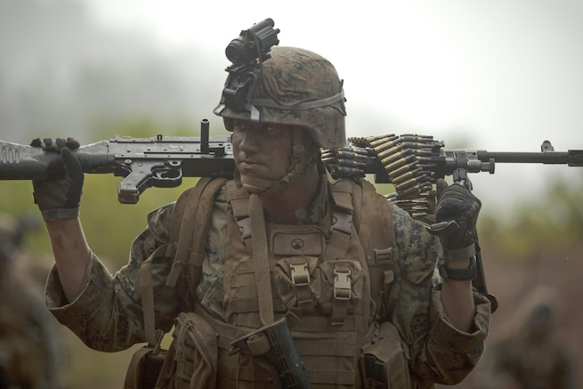 Marine Cpl. Carson P. Burke carries an M240G machine gun during the advanced infantry course at Kahuku Training Area, Hawaii, July 18, 2016. The course is designed to refine leadership abilities for Marines who serve as squad leaders in a rifle platoon. Marine Corps photo by Cpl. Aaron Patterson