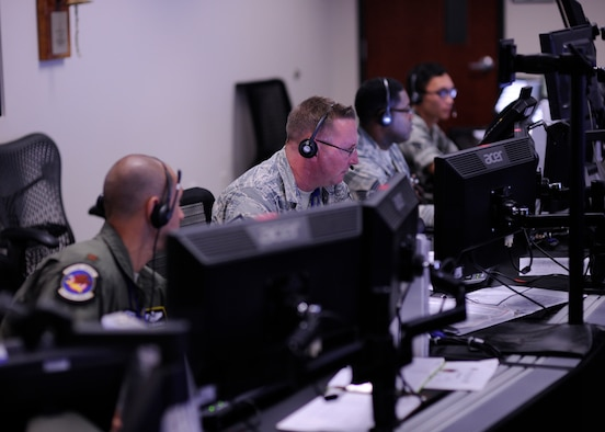 Members of the 81st Range Control Squadron conduct a command and control mission at the 81st RCS, Tyndall Air Force Base, Fla., July 26, 2016. The 81st RCS is the Air Force's only ground control intercept control operation, supporting live air-to-air missile operational test and evaluation. (U.S. Air Force photo by Senior Airman Solomon Cook/Released)