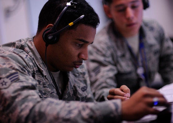 "Senior Airman Steven Jovane from the 81st Range Control Squadron takes instruction from an Airman while preparing to conduct a command and control mission at Tyndall Air Force Base, Fla., July 26, 2016. The 81st Range Control Squadron, also known as, ""Wet Stone,"" provides command and control for air-to-air and air-to-ground live fire missions. (U.S. Air Force photo by Senior Airman Solomon Cook/Released)"