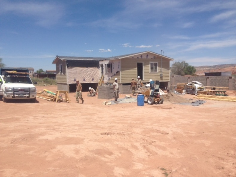 Through the Operation Footprint partnership, twenty-four Air Force Reservists from the 302nd Civil Engineer Squadron helped build new homes for the Navajo Nation during Innovative Readiness Training, May 22 to June 5, 2016 in Gallup, N.M. The 302nd CES contributed to completing the construction of five new homes during their two-week training. (Courtesy photo)