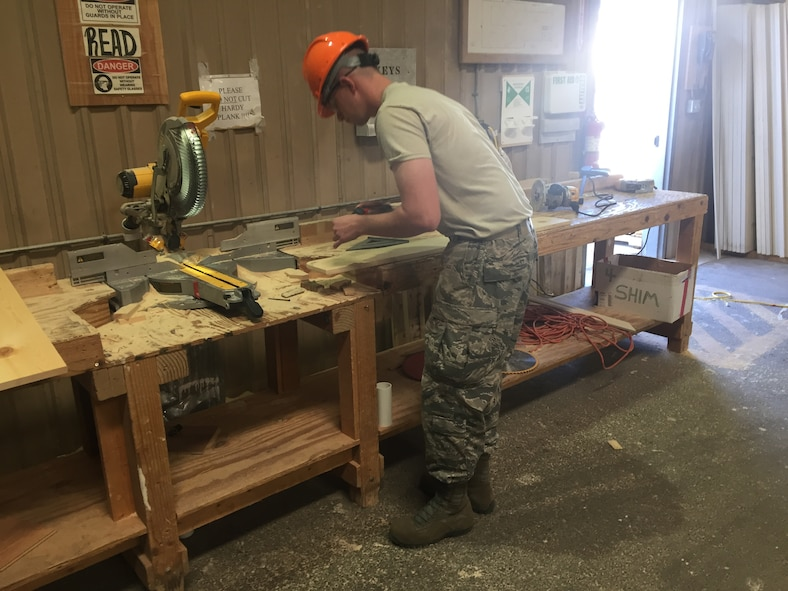 Senior Airman Conner Caron-Burton, 302nd Civil Engineer Squadron engineer apprentice, makes a windowsill for a modular home May 23, 2016 in Gallup, N.M. Eighty five percent of the modular homes are built in a warehouse and transported to the home site when finished. A team of twenty-four Air Force Reservists from the 302nd CES traveled to N.M. for Innovative Readiness Training to help build new homes for the Navajo nation and develop tradesman skills. (Courtesy photo)
