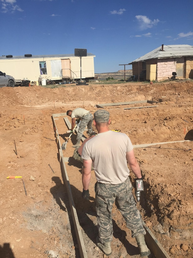 Air Force Reservists from the 302nd Civil Engineer Squadron set up forms to pour concrete for the foundation of a new home May 31, 2016 in Gallup, N.M. As part of the Operation Footprint partnership, twenty-four Reservists from the 302nd CES contributed to completing five new homes for the Navajo Nation while performing Innovative Readiness Training and honing skills for wartime missions. (Courtesy photo)