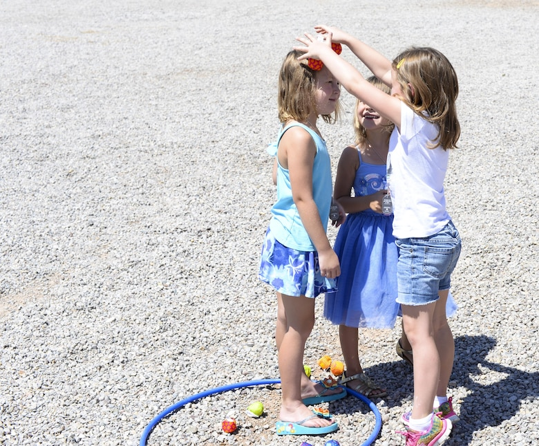 Addalyn, Hailey and Isobel, three children attending the base chapel's vacation bible school, play together during an outdoor activity at Holloman Air Force Base, N.M., on July 20. Children are grouped by age and participate in activities specifically geared towards their age group. (Last names are being withheld due to operational requirements. U.S. Air Force by Amn Alexis P. Docherty/released)