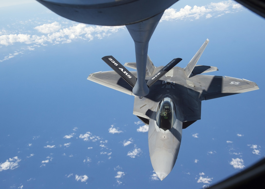 An F-22 Raptor from the 199th Fighter Squadron prepares for air refueling from a KC-135R Stratotanker operated by 465th Air Refueling Squadron from Tinker Air Force Base, Oklahoma, during Rim of the Pacific 2016 over Joint Base Pearl Harbor-Hickam, Hawaii, July 26, 2016. (U.S. Navy photo by Mass Communication Specialist 2nd Class Gregory A. Harden II)