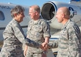 Gen. Ellen M. Pawlikowski (from left), Air Force Materiel Command commander, is greeted by Maj. Gen. David Harris, Air Force Test Center commander, and Brig. Gen. Carl Schaefer, 412th Test Wing commander, as she steps off the plane July 20. (U.S. Air Force photo by Christopher Okula)