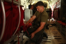 Lance Cpl. Antonio Garcia prepares a C-130 for flight at Marine Corps Base Hawaii, Hawaii, July 26, 2016. Garcia is participating in Rim of the Pacific 2016, a multinational exercise, from June 29 to Aug. 8 in and around the Hawaiian Islands. During RIMPAC, Marine Aerial Refueler Transport Squadron 152 crew members are responsible for preparing aircraft for flight, onloading and offloading cargo, and ensuring the safety of passengers and other crew members. Garcia, a native of East Palo Alto, California, is a crewmaster with VMGR-152 (call sign SUMO), Marine Aircraft Group 24, 1st Marine Aircraft Wing, which supports III Marine Expeditionary Force. (Marine Corps Photo by Cpl. Natalie Dillon)