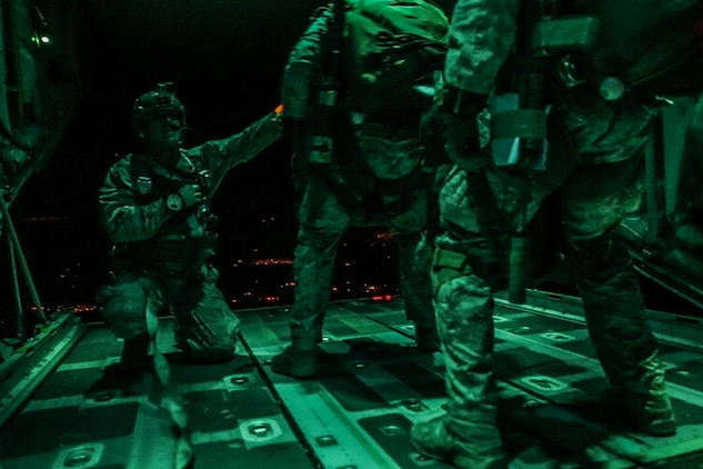 Reconnaissance Marines with Maritime Raid Force, 11th Marine Expeditionary Unit, prepare to aerially insert from a C-130 Hercules aircraft onto a specified objective area located in Southern Calif., June 13, 2016, as part of a reconnaissance and surveillance mission. The mission was conducted during the MEU's Realistic Urban Training exercise, which is held in preparation for the MEU's upcoming Western Pacific 16-2 deployment to the Pacific and Central Commands' areas of operation. (U.S. Marine Corps photo by Lance Cpl. Devan K. Gowans)