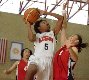 Jessica StCyr of Robbins Air Force Base, Ga., goes in for a layup against China's Jiayi Zuo. USA beat China 73-56 to remain undefeated in day three of the CISM Women's Basketball Championship at Camp Pendleton, Calif., July 27, 2016.