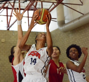 USA's Danielle Salley dominates the offensive board against two defenders from China as USA wins 73-56, in the CISM Women's Basketball Championship, July 27, 2016, at Camp Pendleton, Calif.