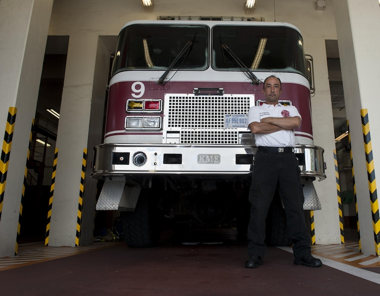 Kenichi Shimajiri, 18th Civil Engineer Squadron fire inspector, stands in front of a fire truck July 27, 2016, at Kadena Air Base, Japan. Shimajiri was a firefighter for 23 years at Kadena before becoming a fire inspector. As a fire inspector, Shimajiri is responsible for ensuring buildings are free of fire hazards. (U.S. Air Force photo by Airman 1st Class Lynette M. Rolen)