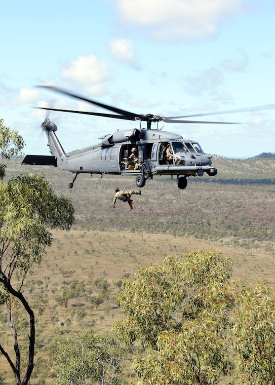 A pararescueman with the 129th Rescue Wing rappels from an HH-60G Pave Hawk helicopter in the High Range of the Australian military zone during operation Angel Reign exercise, July 4, 2016.   (U.S. Air National Guard photo by Senior Airman Zachiah Roberson/released)