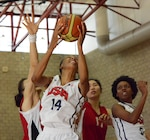 USA Women's Basketball team player Danielle Salley dominates the offensive board against two defenders from China as USA wins, 73-56, in the Conseil International du Sport Militaire's Women's Basketball Championship at Marine Corps Base Camp Pendleton, Calif., July 27, 2016. Army photo by Gary Sheftick