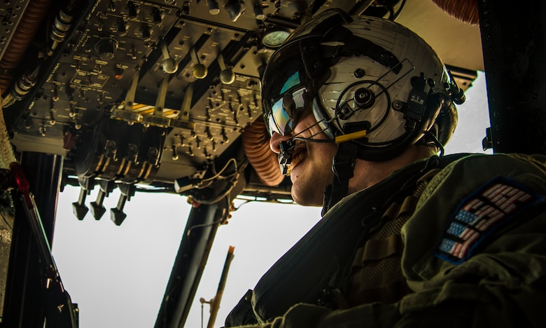 U.S. Navy Petty Officer 2nd Class Morgan Boltz, a naval aircrewman with the Helicopter Mine Countermeasures Squadron 14, Detachment 2A, looks out of the window of an MH-53E Sea Dragon while taking part in Mine Countermeasures Exercise 2JA near Misawa Air Base, Japan, July 22, 2016. The annual bilateral exercise took place between the U.S. and Japan from July 15 to 30, with the goal of strengthening interoperability and mine countermeasure capabilities. (U.S. Air Force photo by Senior Airman Jordyn Fetter)