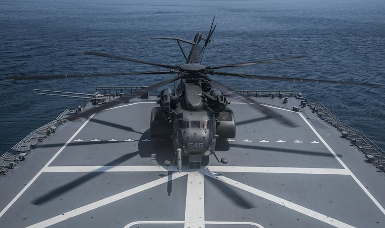An MH-53E Sea Dragon lands on the JS Uraga while taking part in the 2016 Mine Countermeasures Exercise in Mutsu Bay, Japan, July 22, 2016. The Japan Maritime Self-Defense Force vessel's crew teamed up with the U.S. Navy helicopter's unit to train for the boat landing aspect of mine countermeasures. By improving response times and strengthening relations, the services aim to not only become more adept at their mission, but also to deter their enemy's willingness to mine. (U.S. Air Force photo by Senior Airman Jordyn Fetter)