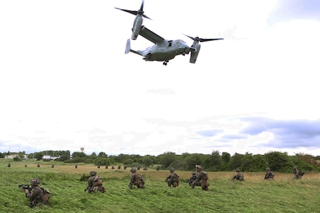 U.S. Marines with Charlie company, 1st Battalion 8th Marine Regiment, Special Purpose Marine Air-Ground Task Force-Crisis Response-Africa provide security at a landing zone during a combined arms attack aboard Camp Sissonne, France, June 21, 2016. During CENZUB training, SPMAGTF-CR-AF Marines had the opportunity to work in cooperation with company of French Army soldiers, integrating their skills and resources including weaponry and military vehicles to form an effective battle plan, similar to what they may face in the event of a future crisis. (U.S. Marine Corps photo by Sgt. Kassie McDole/Released.)