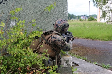 U.S. Marine Corps Lance Cpl. Levi, M. Foss, a rifleman with Charlie Company, 1st Battalion 8th Marine Regiment, Special Purpose Marine Air-Ground Task Force-Crisis Response-Africa posts security on a building corner during a combined arms attack aboard Camp Sissonne, France, June 21, 2016. CENZUB provided SPMAGTF-CR-AF Marines with the ability to maintain their proficiencies in urban combat and integrate with French personnel and assets in a realistic scenario. (U.S. Marine Corps photo by Sgt. Kassie McDole/Released.)