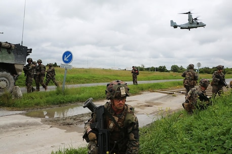 U.S. Marines with Charlie company, 1st Battalion 8th Marine Regiment, Special Purpose Marine Air-Ground Task Force-Crisis Response-Africa provdie security for French Army soldiers with the 34th Infantry Regiment during a combined arms attack aboard Camp Sissonne, France, June 21, 2016. During CENZUB training, SPMAGTF-CR-AF Marines had the opportunity to work in cooperation with company of French Army soldiers, integrating their skills and resources including weaponry and military vehicles to form an effective battle plan, similar to what they may face in the event of a future crisis. (U.S. Marine Corps photo by Sgt. Kassie McDole/Released.)
