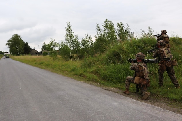 U.S. Marines with Charlie Company, 1st Battatlion 8th Marine Regiment, Special Purpose Marine Air-Ground Task Force-Crisis Response-Africa prepare to engage a vehicle with an M136 AT4 Anti-Tank Rocket training tube during a combined arms attack aboard Camp Sissonne, France, June 21, 2016. During CENZUB training SPMAGTF-CR-AF Marines had the opportunity to work in cooperation with company of French Army soldiers, integrating their skills and resources including weaponry and military vehicles to form an effective battle plan, similar to what they may face in the event of a future crisis. (U.S. Marine Corps photo by Sgt. Kassie McDole/Released.)