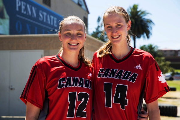 Canadian Army soldiers and biological sisters Lt. Sandy Edmison, left, and Capt. Abby Edmison, right, are both members of the 2016 Canadian Military Women's Basketball Team. The sisters pose together here after the Canada vs. Brazil game at the Conseil International Du Sport Militaire (CISM) World Military Women's Basketball Championship July 27 at Camp Pendleton, California. The base is hosting the CISM World Military Women's Basketball Championship July 25 through July 29 to promote peace activities and solidarity among military athletes through sports. (U.S. Marine Corps photo by Sgt. Abbey Perria)