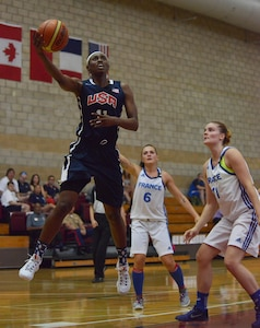 Sgt. Creshenda Singletary of Fort Bragg, N.C.,  hooks it over a French defender during USA's 85-53 win over France, July 26, 2016, at the CISM Women's Basketball Championship tournament at Camp Pendleton, N.C.