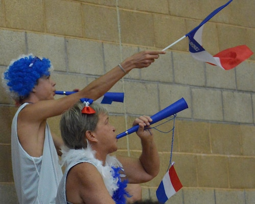 French fans blow their horns and wave their nation's flag after their team scores during day two of the CISM Women's Basketball Championship at Camp Pendleton, Calif., July 26, 2016. Despite their support, France lost to Team USA, 85-53.