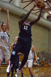 U.S. Army Sgt. Kimberly Smith drives past a French defender to lay it up as USA beat France 85-53 during day two of the CISM Women's Basketball Championship at Camp Pendleton, Calif., July 26, 2016.