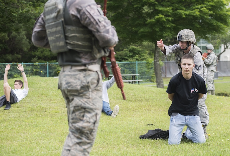 U.S. Air Force Reserve Staff Sgt. Mitchell Melot, a fire team member with the 507th Security Forces Squadron, apprehends a suspect during the Beverly Sunrise 16-05 active shooter exercise held July 29, 2016, at Misawa Air Base, Japan. The 35th Fighter Wing performs these training exercises bi-annually in order to ensure all Misawa personnel know how to properly respond in such a situation. (U.S. Air Force photo by Senior Airman Brittany A. Chase)