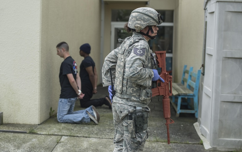 U.S. Air Force Reserve Tech. Sgt. Heather Bennett, a police one patrolman with the 507th Security Forces Squadron, guards suspects during the Beverly Sunrise 16-05 active shooter exercise held July 29, 2016, at Misawa Air Base, Japan. The 35th Fighter Wing performs these training exercises bi-annually in order to ensure all Misawa personnel know how to properly respond in such a situation. (U.S. Air Force photo by Senior Airman Brittany A. Chase)