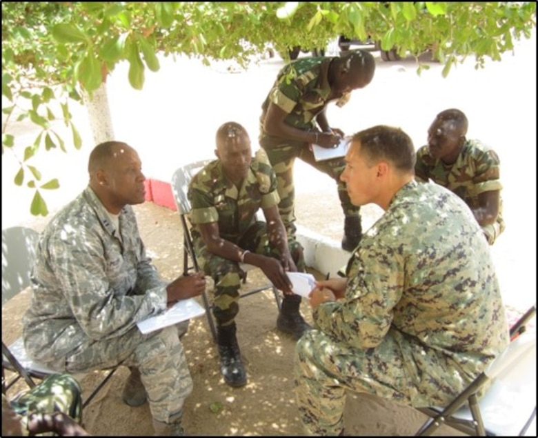 Air Force Capt. Patrick Mudimbi (left) translates for Marine Corps Chief Warrant Officer Jonathan Ross during a training scenario in Senegal for Senegalese soldiers to counter terrorist activities.
