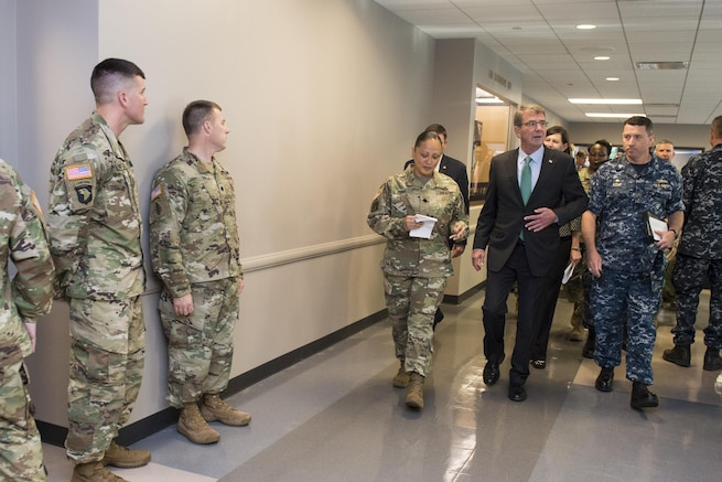 Defense Secretary Ash Carter meets with workers during a visit to the Chicago Military Entrance Processing Station