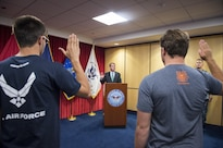 Defense Secretary Ash Carter performs an oath of enlistment ceremony during a visit to the Chicago Military Entrance Processing Station in Chicago, July 28, 2016. DoD photo by Air Force Tech. Sgt. Brigitte N. Brantley