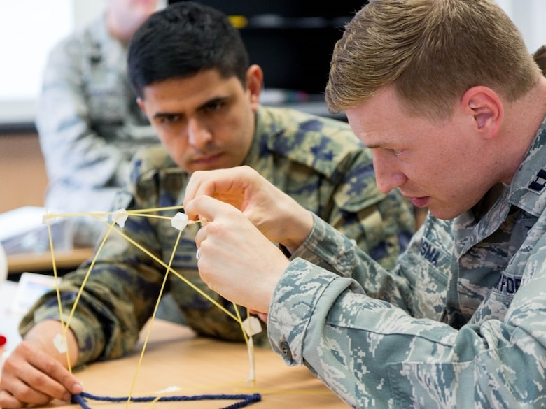 U.S. Air Force Capt. Alexander Roosma, 1st Combat Communications Squadron transmissions systems flight commander, participates in a strategic thinking exercise during the Inter-European Air Force Academy's second combined Squadron Officer School and NCO Academy in-residence course June 20 to July 22, 2016, at Kapaun Air Station, Germany. From June 20 to July 22, 2016, 43 officer and NCO students from 13 European nations and the U.S. participated in the courses. (U.S. Air Force photo/Senior Master Sgt. Travis Robbins)