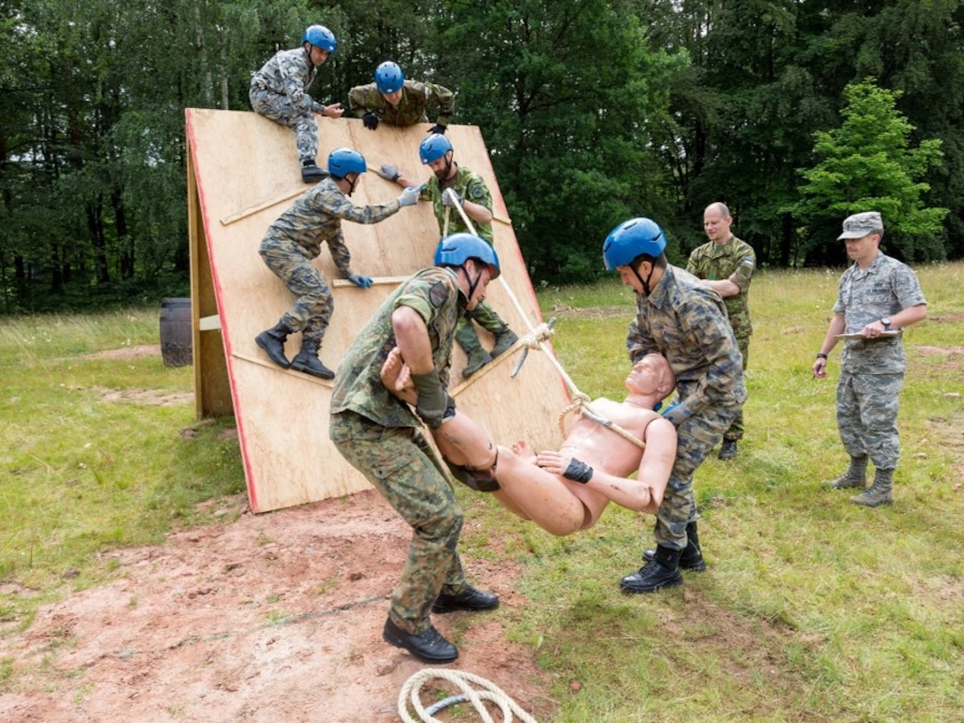 International officers and NCOs participate in a leadership reaction course during the Inter-European Air Force Academy's second combined Squadron Officer School and NCO Academy in-residence course June 20 to July 22, 2016, at Kapaun Air Station, Germany. From June 20 to July 22, 2016, 43 officer and NCO students from 13 European nations and the U.S. participated in the courses. (U.S. Air Force photo/Senior Master Sgt. Travis Robbins)