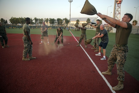 Marines with Special Purpose Marine Air-Ground Task Force Crisis Response-Africa hold a physical training event with Celebrity Chef Robert Irvine at Naval Air Station Sigonella, Italy, July 28, 2016.  Marines completed a circuit course with Irvine, which included upper and lower body workouts, Marine Corps Martial Arts Program techniques and laps around the baseball field.  (U.S. Marine Corps photo by Cpl. Alexander Mitchell/released)