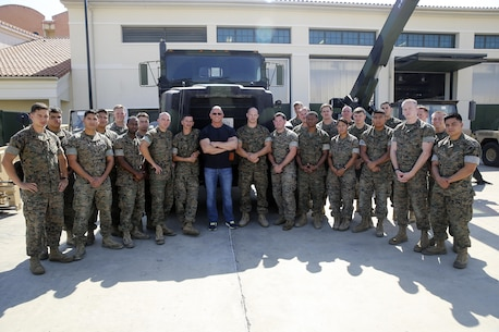 Celebrity Chef Robert Irvine and Marines with Special Purpose Marine Air-Ground Task Force Crisis Response-Africa pose for the group photo during a static display at Naval Air Station Sigonella, Italy, July 28, 2016.  Marines displayed some of their capabilities and vehicles for Irvine and had a chance to have conversations with him. (U.S. Marine Corps photo by Cpl. Alexander Mitchell/released)