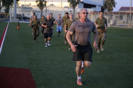 Celebrity Chef Robert Irvine and Marines with Special Purpose Marine Air-Ground Task Force Crisis Response-Africa run around the baseball field after a workout during a physical training event at Naval Air Station Sigonella, Italy, July 28, 2016.  Marines completed a circuit course with Irvine, which included upper and lower body workouts, Marine Corps Martial Arts Program techniques and laps around the baseball field.  (U.S. Marine Corps photo by Cpl. Alexander Mitchell/released)