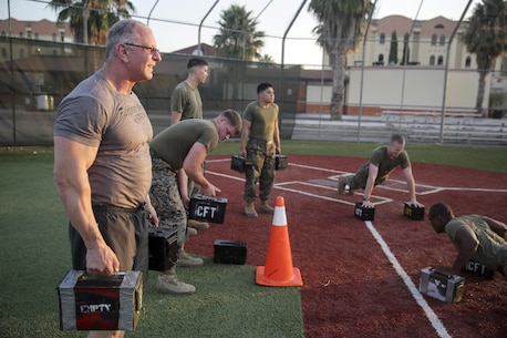Celebrity Chef Robert Irvine and Marines with Special Purpose Marine Air-Ground Task Force Crisis Response-Africa conduct workouts with 35-pound ammo cans during a physical training event at Naval Air Station Sigonella, Italy, July 28, 2016.  Marines completed a circuit course with Irvine, which included upper and lower body workouts, Marine Corps Martial Arts Program techniques and laps around the baseball field.  (U.S. Marine Corps photo by Cpl. Alexander Mitchell/released)