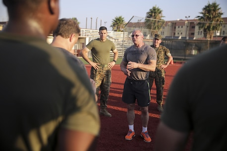 Celebrity Chef Robert Irvine speaks to Marines with Special Purpose Marine Air-Ground Task Force Crisis Response-Africa Logistics Combat Element and thanks them for a great workout after a physical training event at Naval Air Station Sigonella, Italy, July 28, 2016.  Marines completed a circuit course with Irvine, which included upper and lower body workouts, Marine Corps Martial Arts Program techniques and laps around the baseball field.  (U.S. Marine Corps photo by Cpl. Alexander Mitchell/released)