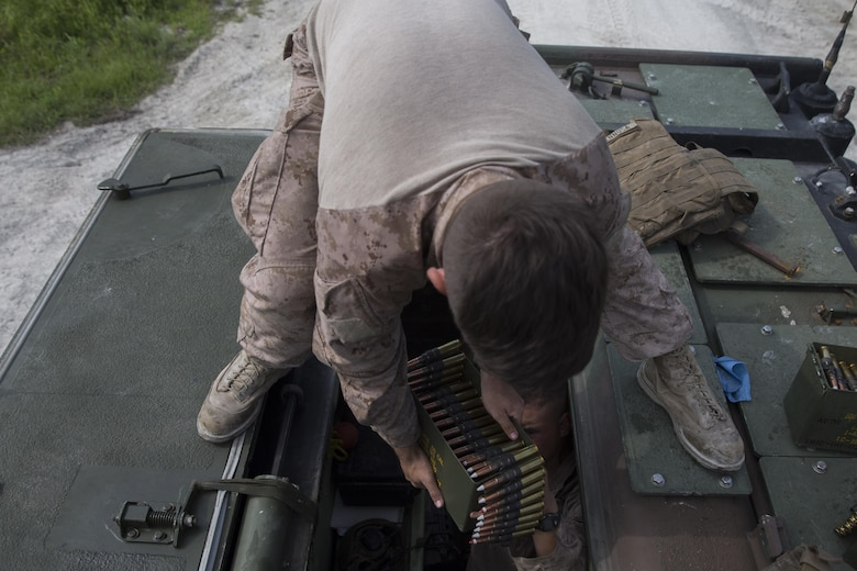 A Marine with Alpha Company, 2nd Assault Amphibian Battalion, prepares .50 caliber rounds prior to a live-fire gunnery range at Camp Lejeune, N.C., July 27, 2016. Individual Marines were required to engage ivan and hard targets at various ranges while determining whether to use the M-2 .50 caliber machine gun or the MK-19 40mm grenade launcher.