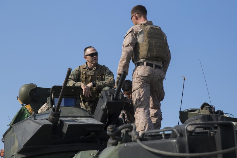 Maj. Gen. John K. Love, 2nd Marine Division commanding general, speaks with Marines before conducting a live-fire gunnery range at Camp Lejeune, N.C., July 27, 2016. Marines with 2nd Assault Amphibian Battalion spent the day refining their marksmanship skill as individuals and their ability to work as an AAV crew.