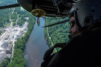 Navy Senior Chief Paul Morreira surveys a landing zone from the window of an MH-53E Sea Dragon during training to familiarize the crew with mountainous terrain near Camp Dawson in W.Va., July 22, 2016. The squadron participated in the two-day training evolution as part of an upcoming exercise with the Army. Morreira is a crewman assigned to Helicopter Mine Countermeasures Squadron 15. Navy photo by Petty Officer 1st Class Barry A. Riley