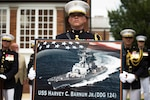 WASHINGTON (July 28, 2016) A Marine holds a poster of the future Arleigh Burke-class guided-missile destroyer USS Harvey C. Barnum, Jr. during a ceremony in at the Marine Barracks in Washington, D.C., July 28, 2016. Marine Corps photo by Cpl. Remington Hall