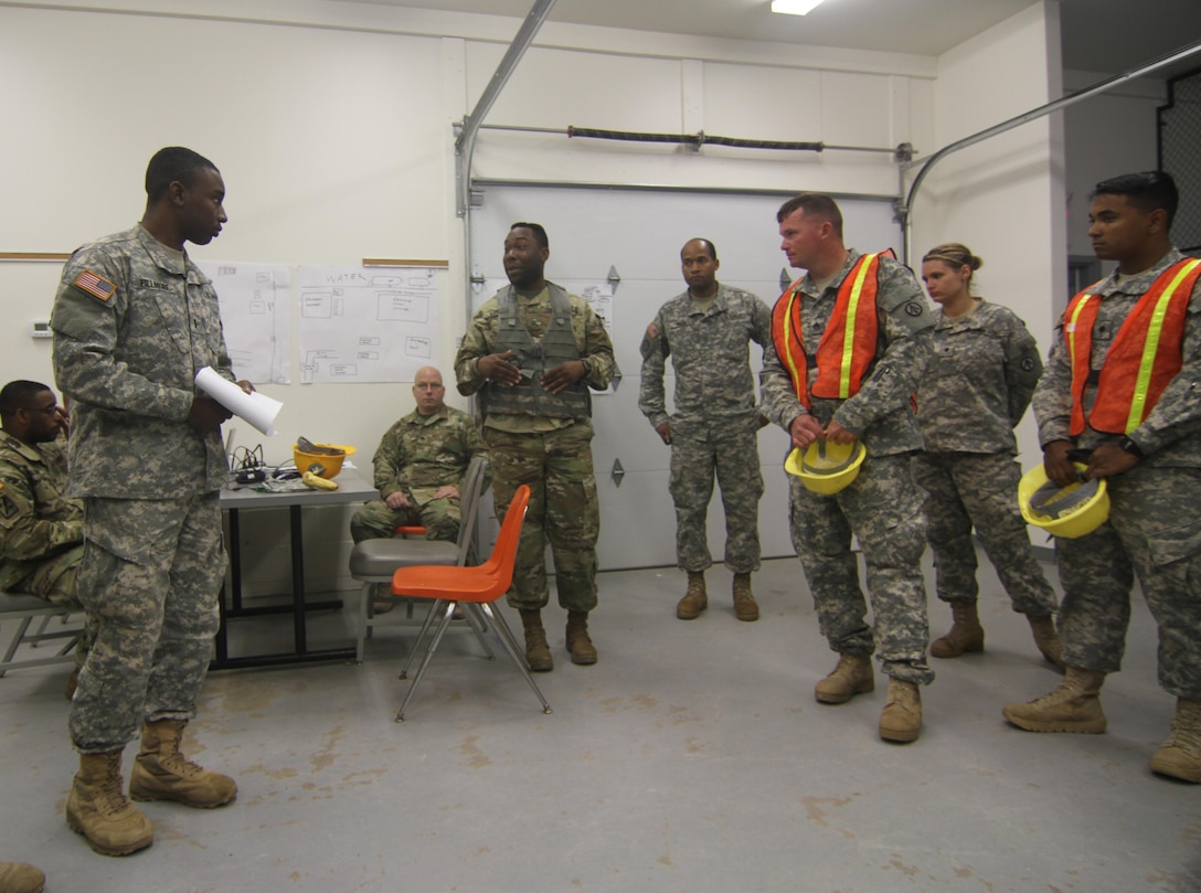Supplying the warfighter with strategic deployment capabilities. 1st Lt. Quentin Fillmore, battle captain, and Staff Sgt.  Orion Barnes, automated information for movement systems non-commissioned officer in charge of the 352d Expeditionary Terminal Operations Element based in Sanford, Florida, brief the unit during Army Reserve exercise TRANS WARRIOR 2016. The exercise provides Mission Essential Task List focused training and  addresses fundamental Soldier skills. The TRANSWARRIOR exercise lasted from July 9 to July 23, 2016. (U.S. Army Reserve photo by 1st Sgt. Timothy Lawn, 205th Press Camp Headquarters)