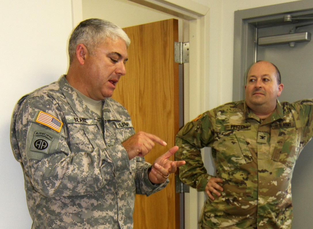 Supplying the warfighter with strategic deployment capabilities. Col. Michael Beane, operations officer for the Deployment Support Command based in Birmingham, Ala., and COL Kenneth Fetzer, 1190th Transportation Brigade Commander discuss pre-established goals of Army Reserve exercise TRANS WARRIOR 2016.  The exercise lasted from July 9 to July 23, 2016 and provided the troops an opportunity to train on fundamental Soldier skills. (U.S. Army Reserve photo by 1st Sgt. Timothy Lawn, 205th Press Camp Headquarters)