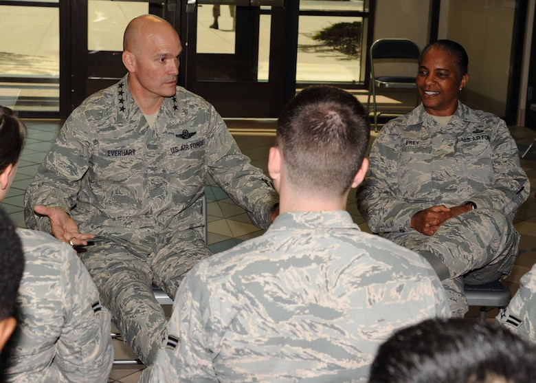 Gen. Carlton D. Everhart II, Air Mobility Command commander, left, and Chief Master Sgt. Shelina Frey, Air Mobility Command command chief, speak with Airmen July 28, 2016, on Grand Forks Air Force Base, N.D. Everhart and Frey toured the dorms and spoke with Airmen about their concerns and hopes for the base and the future of the U.S. Air Force. (U.S. Air Force photo by Senior Airman Ryan Sparks/Released)