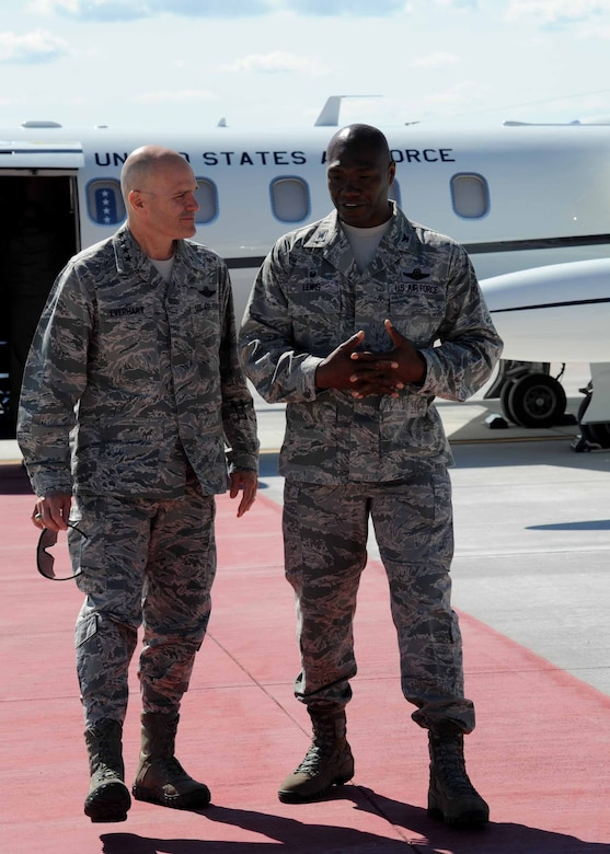 Gen. Carlton D. Everhart II, Air Mobility Command commander, left, is greeted by Col. Rodney Lewis, 319th Air Base Wing commander, July 27, 2016, on Grand Forks Air Force Base, N.D.  Everhart and Chief Master Sgt. Shelina Frey, Air Mobility Command command chief, visited Grand Forks AFB to check on the well-being of Airmen and the mission. (U.S. Air Force photo by Senior Airman Ryan Sparks/Released)