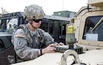 New York Army National Guard Spc. Joseph Lebeck, a logistics noncommissioned officer in Headquarters Company, 1st Battalion, 69th Infantry, makes last-minute adjustments to the Multiple Integrated Laser Engagement System sensors on his Humvee at the Joint Rotational Training Center at Fort Polk, La., July 16, 2016. More than 3,000 New York Army National Guard soldiers deployed to Fort Polk for a July 9-30 exercise at the JRTC. Army National Guard photo by Sgt. Michael Davis