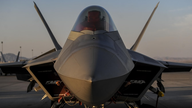 An F-22A Raptor, assigned to the 27th Fighter Squadron, Joint Base Langley-Eustis, Va., sits on the runway during Red Flag 16-3 at Nellis Air Force Base, July 25, 2016. Red Flag provides an opportunity for aircrew and military aircraft the ability to enhance their tactical operational skills alongside military aircraft from coalition forces. (U.S. Air Force photo by Airman 1st Class Kevin Tanenbaum/Released)
