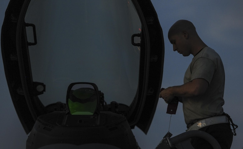 A maintainer, assigned to the 27th Fighter Squadron, Joint Base Langley-Eustis, Va., prepares the cockpit of an F-22A Raptor prior to take-off during Red Flag 16-3 at Nellis Air Force Base, Nev., July 25, 2016. Red Flag involves a variety of attack, fighter, bomber, reconnaissance, electronic warfare, airlift support, and search and rescue aircraft. (U.S. Air Force photo by Airman 1st Class Kevin Tanenbaum/Released)