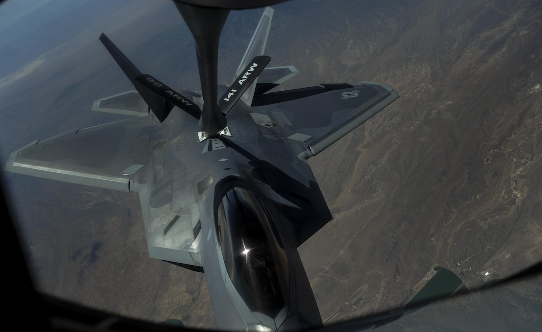 An F-22A Raptor, assigned to the 27th Fighter Squadron, Joint Base Langley-Eustis, Va., is refueled in-air by a KC-135 Stratotanker during Red Flag 16-3 over the Nevada Test and Training Range, Nev., July 27, 2016. In addition to providing fuels for aircraft in mid-air, the KC-135 can carry up to 83,000 pounds of cargo. (U.S. Air Force photo by Airman 1st Class Kevin Tanenbaum/Released)